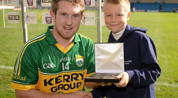 Kerry's Pádraig Boyle is presented with the Man of the Match by Tomás Gaughan, from Meath