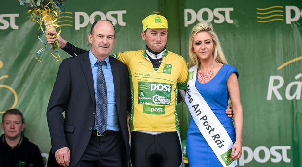Stage winner Robert McCarthy, An Post Chain Reaction, is presented with the yellow jersey after winning the opening stage of the 2014 An Post Rás