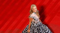 Socialite Paris Hilton poses on the red carpet as she arrives for the film