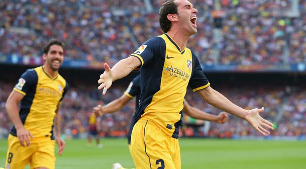 Diego Godin of Club Atletico de Madrid celebrates after scoring his goal during the La Liga match between FC Barcelona and Club Atletico de Madrid at Camp Nou on May 17, 2014 in Barcelona, Spain