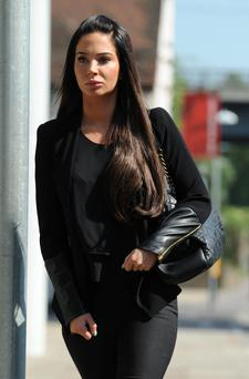 Tulisa Contostavlos arrives to face assault charges at Chelmsford Magistrates Court . (Photo by Stuart C. Wilson/Getty Images)