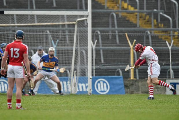 Anthony Nash strikes Cork's third goal during their NHL quarter-final clash against Tipperary