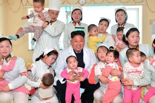 North Korean leader Kim Jong Un smiles during a visit to Taesongsan General Hospital in this undated photo released by North Korea's Korean Central News Agency (KCNA) in Pyongyang May 19, 2014. REUTERS/KCNA