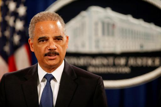 Attorney General Eric Holder announces that a US grand jury has charged five Chinese hackers with economic espionage and trade secret theft.