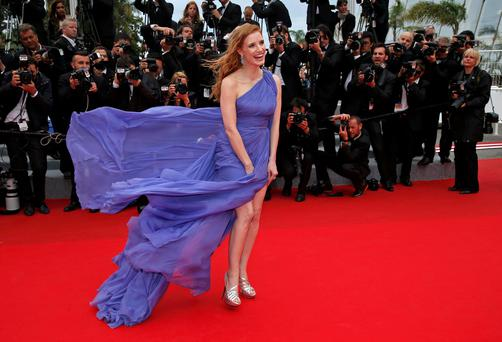 "Actress Jessica Chastain poses on the red carpet as she arrives for the screening of the film ""Foxcatcher"" in competition at the 67th Cannes Film Festival."