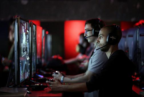 Gamers play Xbox One games consoles during the Eurogamer Expo 2013 in London. Twitch is the most popular service for streaming video game footage