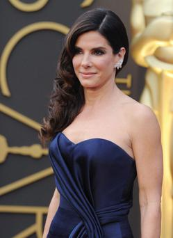 Actress Sandra Bullock arrives at the 86th Annual Academy Awards at Hollywood & Highland Center on March 2, 2014 in Hollywood, California. (Photo by Axelle/Bauer-Griffin/FilmMagic)