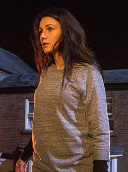 Tina McIntyre, played by Michelle Keegan, just before she plunges to the cobbles from the balcony of the builders' yard