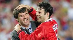 Manchester United's suspended captain Roy Keane (L) hugs Ryan Giggs, after United defeated Bayern Munich to win the Champions League in 1999. Phil Noble/PA Wire.