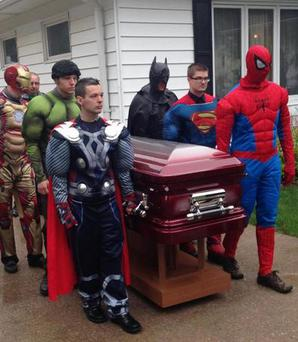 Superhero pallbearers at the five-year-old's funeral. Photo: Cory Denton