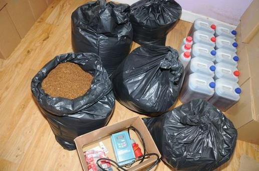 Items discovered included tobacco worth €850,000, boxes of cigarettes, alcohol labels and 60 litres of what appears to be un-distilled alcohol.