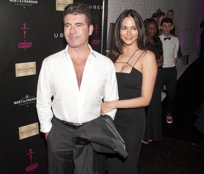 Simon Cowell and Lauren Silverman are seen leaving the Collection Club, Knightsbridge in London, England. (Photo by Niki Nikolova/GC Images)