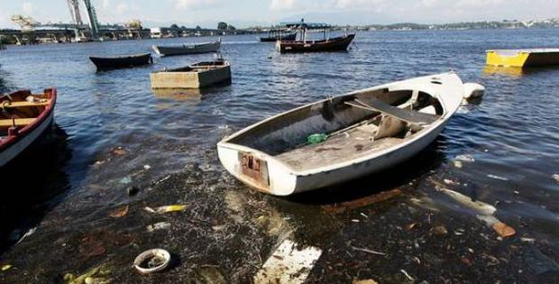 Athletes have described having to dodge a deluge of rubbish including floating mattresses, car tyres, submerged sofas, dog carcasses and even human corpses.