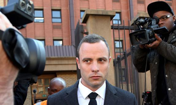 Oscar Pistorius leaves the high court in Pretoria. AP