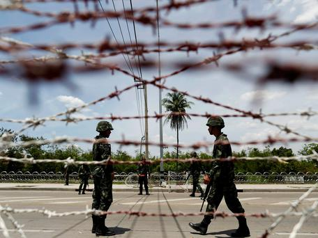 Thai soldiers man a checkpoint near pro-government