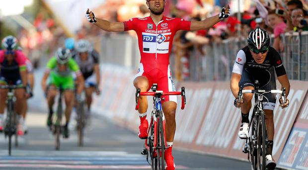 Nacer Bouhanni of France and FDJ.fr (C) celebrates after winning the tenth stage of the 2014 Giro d'Italia, a 173km stage between Modena and Salsomaggiore in Modena, Italy. (Photo by Harry Engels - Velo/Getty Images)