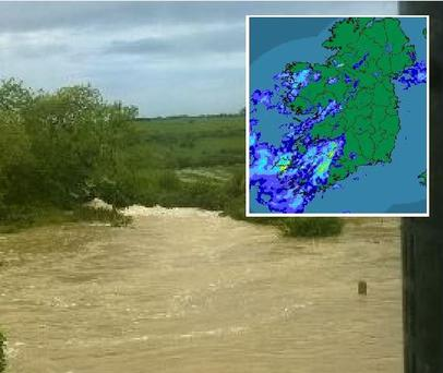 Road in Ballyvaughan, Co Clare washed away. Inset: Heavy rainfall across the south and south-west of country this evening