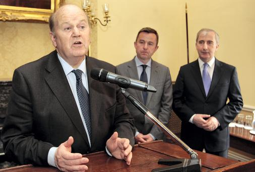 Michael Noonan,TD,the Minister for Finance, with Junior Minister Brian Hayes TD, the Fine Gael European Election candidate for Dublin and Gay Mitchell, the retiring Fine Gael MEP for Dublin. Picture: Tom Burke