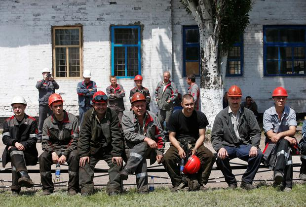 Employees of the Ilyich Iron and Steel Works sit during a rally to protest against actions of armed separatists, in Mariupol, eastern Ukraine. Factories sounded their sirens in two cities of eastern Ukraine on Tuesday and steel workers held a peace rally in support of a call by Ukraine's richest man, Rinat Akhmetov, for protests against armed separatists who plan to disrupt a May 25 presidential election. Reuters