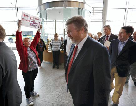 Protester Nora Byrne makes her feelings known about lost medical cards during Health Minister James Reilly's visit to the Mater Hospital in Dublin yesterday. Photo: Sasko Lazarov/Photocall Ireland