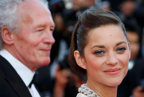 "Marion Cotillard on the red carpet before the screening of the film ""Deux jours, une nuit"" (Two Days, One Night). Reuters/Yves Herman"