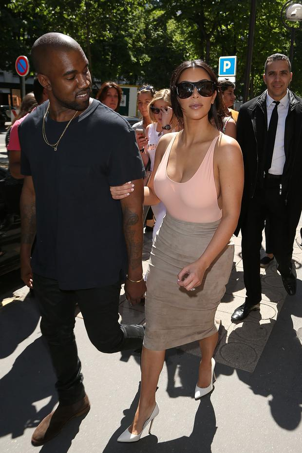 5dac87ceaa3 Kim Kardashian and Kanye West are seen strolling on the  Avenue Montaigne