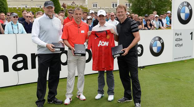 Rory McIlroy of Northern Ireland poses with (L-R) Peter Schmeichel, Phill Neville and Teddy Sheringham during the Pro-Am ahead of the BMW PGA Championship at Wentworth