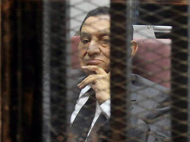 Egypt's ousted President Hosni Mubarak looks on as he reacts inside a dock at the police academy on the outskirts of Cairo. REUTERS/Stringer
