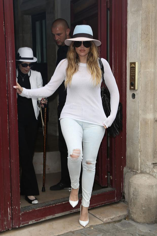 Khloe Kardashian and Mary Jo Shannon leave Kim Kardashian's appartment on May 20, 2014 in Paris, France. (Photo by Marc Piasecki/GC Images)