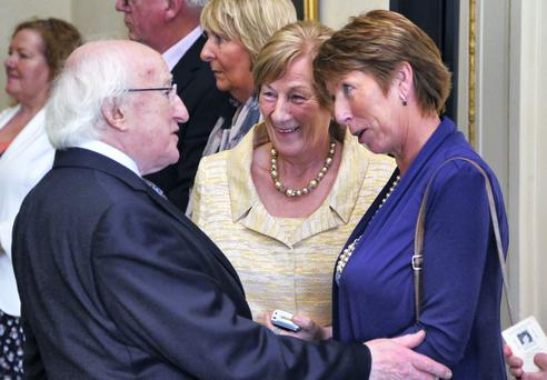 President Michael D Higgins meets sisters, Maura Kelleher, left from Cork and Frances Bergin from Clare, who lost their sister, Josie Bradley in the Talbot Street bombing. Picture: Colin Keegan, Collins Dublin.