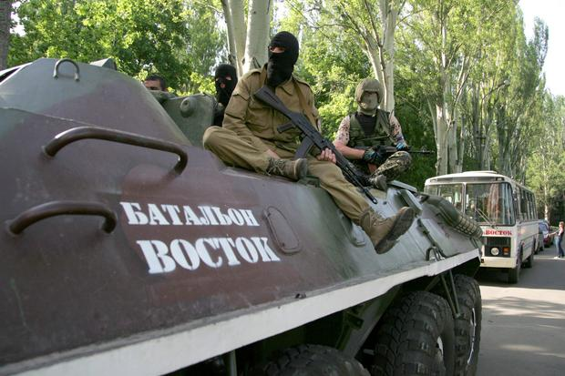 Pro-Russian gunmen atop of an armored personnel carrier with the words read 'Battalion Vostok (East)' patrol a street in Donetsk, Ukraine. One rebel leader in Donetsk, Denis Pushilin, retaliated Tuesday by threatening to nationalize Akhmetovs assets over his refusal to pay taxes to the Donetsk Peoples Republic. AP