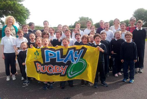 Teachers and pupils of Killtallagh NS, Castlemain receiving their Play Rugby pack after participating in the IRFU Play Rugby programme.
