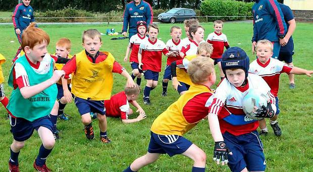 Andrew Conway, Paddy Ryan and Peter O'Mahony at the Muskerry Summer Camp
