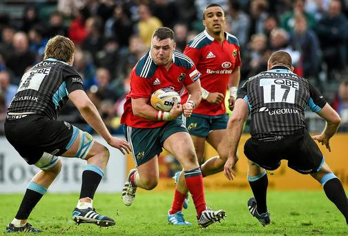 Munster's Dave Kilcoyne in action against Glasgow Warriors' Jonny Gray, left, and Gordon Reid at Scotstoun Stadium last weekend
