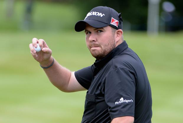 Shane Lowry acknowledges the crowd on the 18th green during day one of the BMW PGA Championship at Wentworth. Photo: Ross Kinnaird/Getty Images
