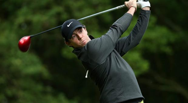 Rory McIlroy tees off on the third hole during day one of the BMW PGA Championship at Wentworth. Photo: Warren Little/Getty Images