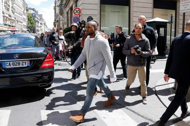 Rapper Kanye West arrives at a fashion designer shop in Paris. US television personality Kim Kardashian and rapper Kanye West will celebrate their wedding in Florence on May 25, an official from the mayor's office confirmed on Friday. Reuters