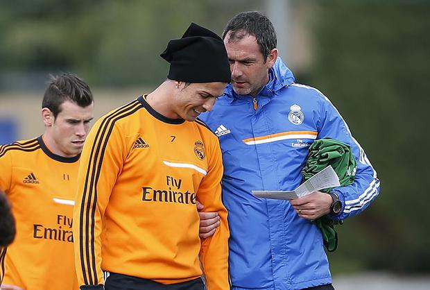 Cristiano Ronaldo talks with Real Madrid assistant coach Paul Clement