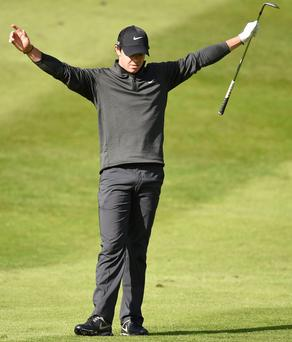 Northern Ireland's Rory McIlroy celebrates chipping in for an eagle during day one of the BMW PGA Championship at the Wentworth