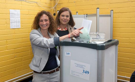 Lynn Boylan, a Sinn Fein EU candidate in Dublin casts her vote in Scoil Aine, New Road, Clondalkin, Dublin. She's pictured here with Mary Lou McDonald TD. Photo: Gareth Chaney Collins