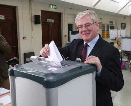 Tanaiste, Eamon Gilmore, TD casts his vote in the at Scoil Mhuire in Shankill. Photo: Damien Eagers