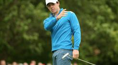 Rory McIlroy reacts to a putt during day two of the BMW PGA Championship at Wentworth