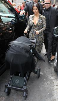 Kim Kardashian seen leaving an apartment on May 23, 2014 in Paris, France. (Photo by Neil P. Mockford/GC Images)