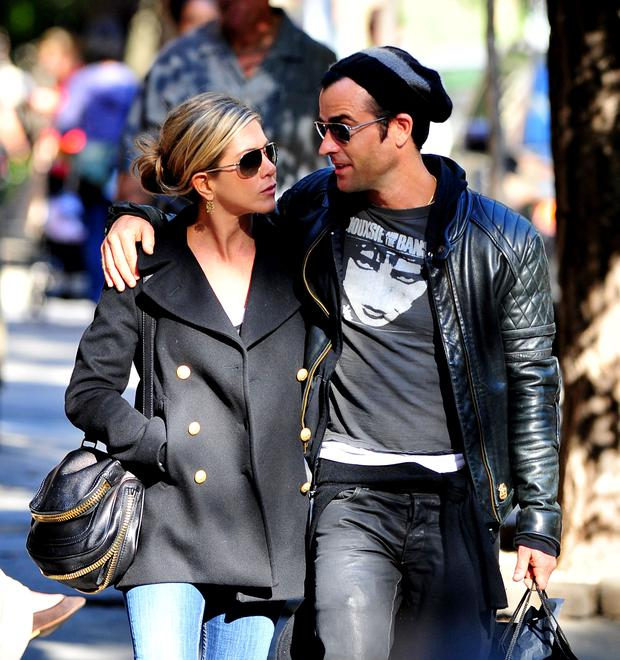 Jennifer Aniston and Justin Theroux walk in the West Village