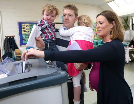 Janet and Brian Campbell cast their vote with the help of their children Niall and Mary at Scoil Mhuire in Shankill, Co Dublin. Picture: Damien Eagers