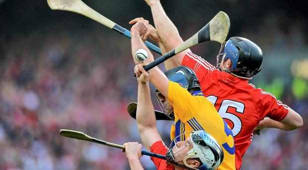 Cork's Cian McCarthy and Conor Lehane contest a dropping ball against Clare's Brendan Bugler. The two sides could meet again in the Munster semi-final. Photo: Brendan Moran / SPORTSFILE
