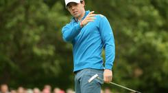 Rory McIlroy reacts after missing a putt at Wentworth yesterday. Photo: by Ian Walton/Getty Images