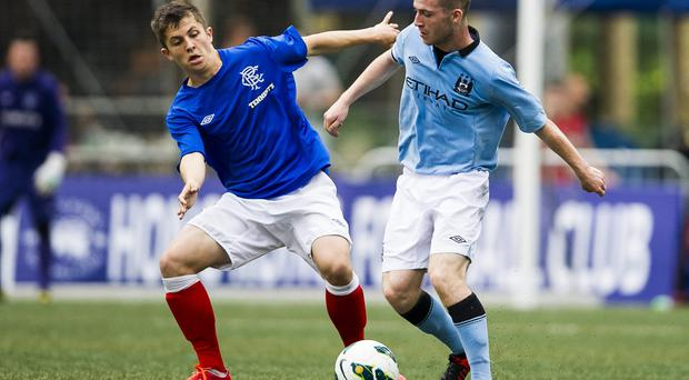 Jack Byrne, right, in action for Manchester City