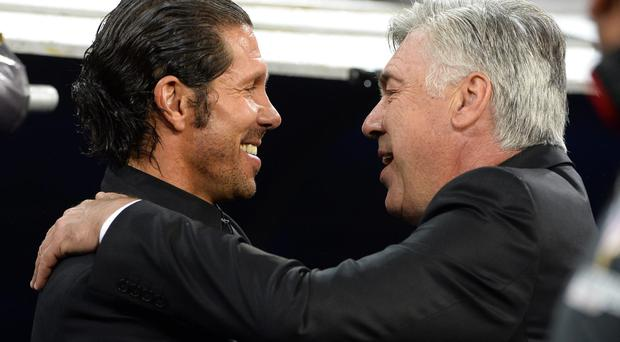 Atletico Madrid coach Diego Simeone and Real Madrid coach Carlo Ancelotti