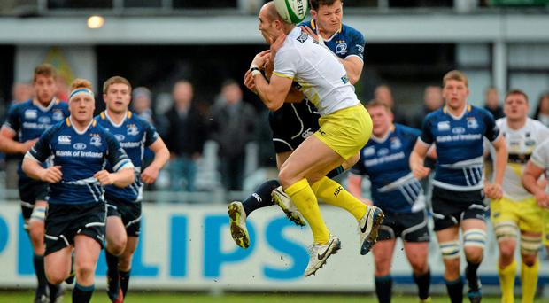 Sam Coghlan Murray, Leinster A, is tackled by David Doherty, Leeds Carnegie